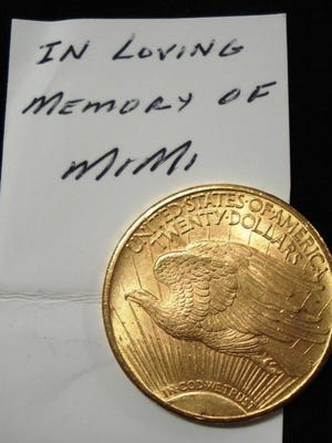 """This 1925 $20 gold piece, with a note dedicating it to """"Mimi,"""" was received by the Salvation Army in Fort Myers last year."""