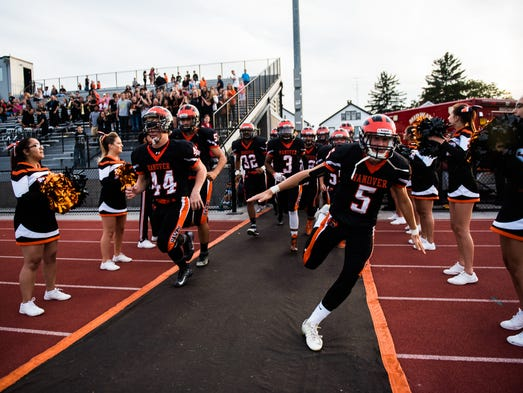 Hanover players take the field Friday Sept. 2, 2016