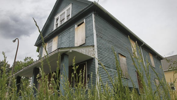 FILE PHOTO: A boarded up house on N. Union St. in Rochester