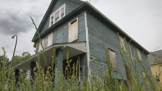 "FILE PHOTO: A boarded up house on N. Union St. in Rochester is one of dozens of ""zombie"" properties in the city."