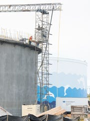 Workers construct a new water tank Monday, Dec. 4,
