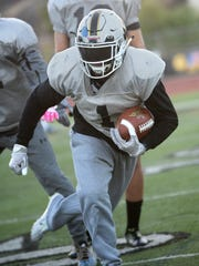 Brendan Radley-Hiles carries the ball during Calabasas'