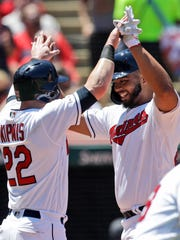 Cleveland Indians' Bobby Bradley, right, and Jason Kipnis celebrate after both score on a throwing error by Detroit Tigers' Niko Goodrum in the second inning in a baseball game, Sunday, June 23, 2019, in Cleveland. (AP Photo/Tony Dejak)