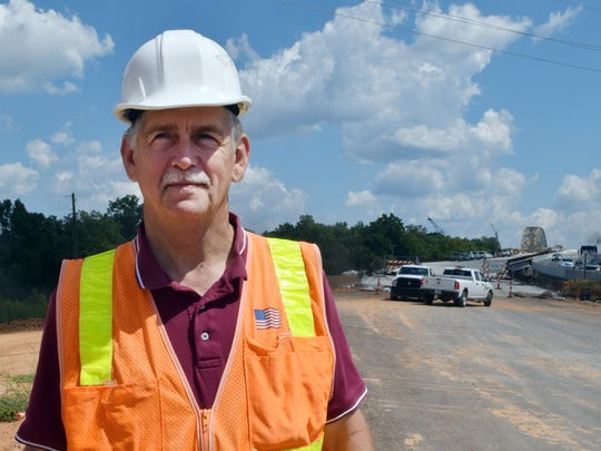John Gagnard, project engineer, said the O.K. Allen Bridge demolition went off smoothly. He is shown a few days before the demolition when the O.K. Allen Bridge (background) was still standing.
