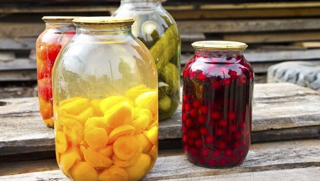 Canning is a practical way to preserve your garden's produce.