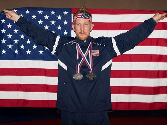 Endicott resident Jason Goldman  poses with his two silver medals he won at the Veterans World Championships wrestling competition at Belgrade, Serbia.