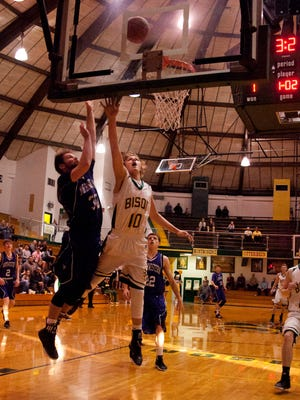 Benton Central's Blake Morin attacks the basket. Morin is one of the few returning experienced players for the Bison.