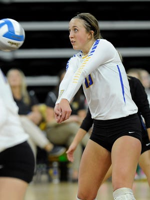 Aberdeen Central's #13 Brianna Kusler bumps the volleyball against O'Gorman during state  semifinals volleyball action at the Denny Sanford Premier Center in Sioux Falls, S.D., Friday, Nov. 20, 2015.