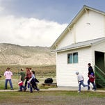 Students leave the gymnasium/cafeteria and head back to classes at Adel Middle School in the small south-central Oregon community of Adel, Ore., April 15, 2004.