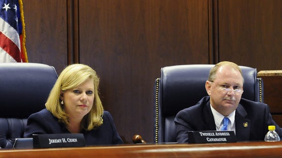 Public Service Commission members  Twinkle Andress Cavanaugh and Terry Dunn listen during a public meeting on Alabama Power rates in front of the PSC in 2013.