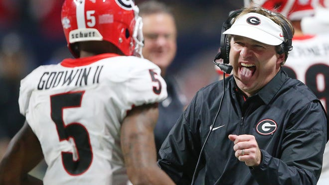 FILE - In this Dec. 2, 2017, file photo, Georgia head coach Kirby Smart reacts after Georgia wide receiver Terry Godwin (5) scored a touchdown against Auburn during the second half of the Southeastern Conference championship NCAA college football game in Atlanta. After leading Georgia to the national championship game, football coach Kirby Smart has been rewarded with a seven-year contract worth $49 million. Georgia's athletic association approved the contract extension and new compensation package Thursday, May 3, 2018. (AP Photo/John Bazemore, File)