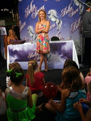 Actress Hayden Panettiere talks with fans at Gen Con