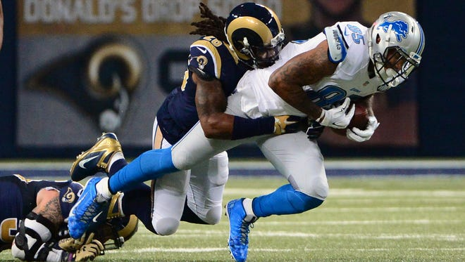 Dec 13, 2015; St. Louis, MO, USA; Detroit Lions tight end Eric Ebron (85) is tackled by St. Louis Rams outside linebacker Mark Barron (26) during the first half at the Edward Jones Dome.