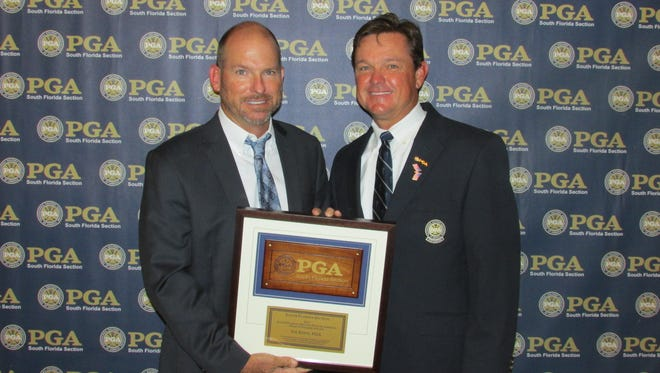 Golf pro Joe Kern, left, was honored by the South Florida PGA on Monday night with the Deacon Palmer Award at their annual awards dinner at Parkland Golf & Country Club.