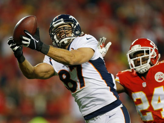 FILE - In this Dec. 1, 2013 file photo, Denver Broncos wide receiver Eric Decker (87) makes a touchdown reception against Kansas City Chiefs cornerback Brandon Flowers (24) during the second half of an NFL football game in Kansas City, Mo. Where will Maurice Jones-Drew, Decker and Michael Vick wind up. They are some of the best-known players available as NFL free agency begins. (AP Photo/Ed Zurga, File)