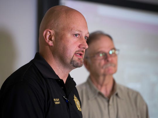 McMinn County Sheriff Joe Guy, left, and Athens Police Chief Chuck Ziegler respond to questions during a news conference regarding a shooting that left three dead at Thomas and Betts Corp. in Athens, Tenn.