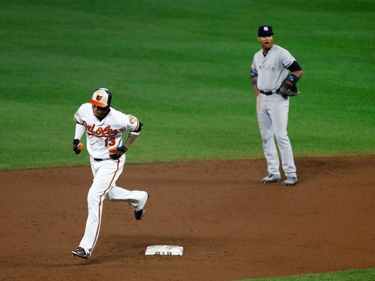 Baltimore Orioles' Manny Machado, left, rounds the