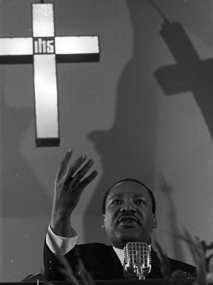 Martin Luther King Jr speaking to an audience at Dexter Avenue Baptist Church in Montgomery Alabama.
