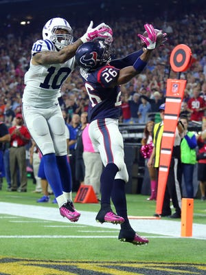 Houston Texans free safety Rahim Moore (26) intercepts the ball intended for Indianapolis Colts wide receiver Donte Moncrief (10) in the end zone, however, the play was called back due to a defensive penalty on the play during the second half of an NFL football game Thursday, Oct. 8, 2015, at NRG Stadium in Houston, Texas.