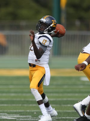Detroit East English's Charles Lake passes against River Rouge during the first half of East English's 38-29 win on Saturday, Aug. 26, 2017, at Wayne State.
