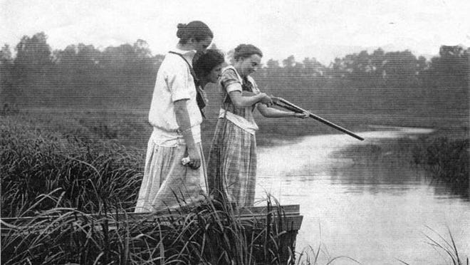 Residents scan the water with a shotgun at Matawan Creek following the 1916 shark attacks.