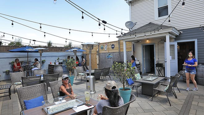 Outdoor dining at he Pour Yard on Washington Street in Quincy Point.