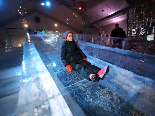 Natalie Leybov of Hopatcong takes a ride down the Natural Ice Slide at the frozen in Ice Carnival at the Skylands Stadium in Frankford is an ice sculpture extravaganza featuring more than 100 tons of ice sculptures, food, and entertainment. February 18, 2017, Frankford Township, NJ.