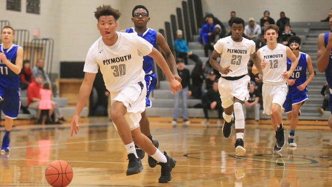 Plymouth's AJ Neal (No. 30) leads the Wildcats up the floor Friday. Right behind him are teammates Connor Bush (No. 23) and Joey Robb (No. 12).