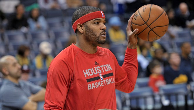 Houston Rockets forward Josh Smith warms up before his debut with the NBA basketball game, against the Memphis Grizzlies on Friday, Dec. 26, 2014, in Memphis, Tenn.