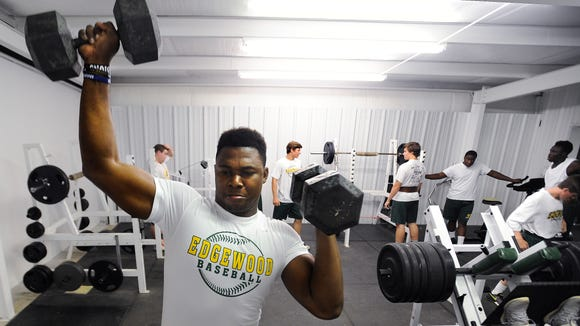 Prince Tega Wanogho works out in the weight room with fellow Edgewood Academy athletes at the school in Elmore, Ala. on Tuesday April 21, 2015. He has reportedly gained 32 pounds in his first year at Auburn.