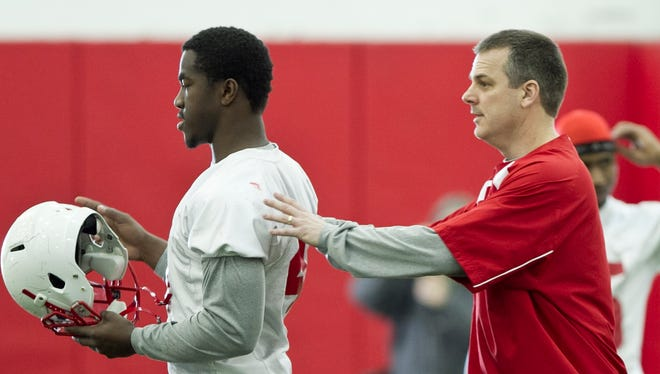 FILE – Nebraska linebackers coach Ross Els, right, works with Lavonte David, March 12, 2011. Els was hired as Purdue's defensive coordinator on Friday.