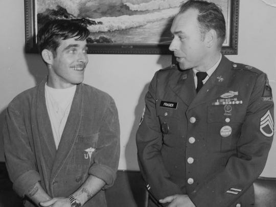 Army Staff Sgt. James Pfister (left) is met by his sponsor and longtime family friend, Staff Sgt. Kenneth Frasier, after returning to the United States by way of Fort Knox, Ky., after spending nearly five years in a North Vietnamese prison camp in 1973.