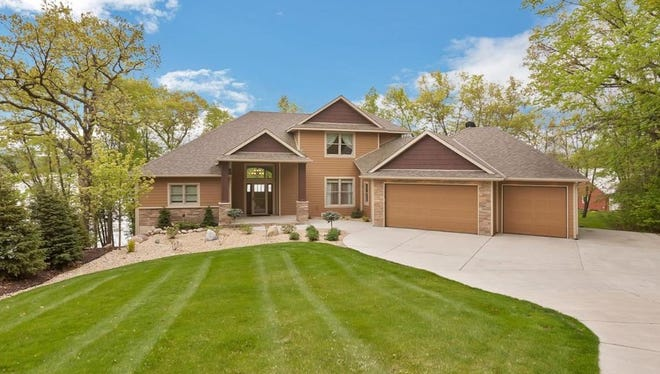 Listed at $975,000 by Edina Realty agent Josiah Fuchs, the home at 12262 Louisa Court in South Haven sits on 1.2 acres.