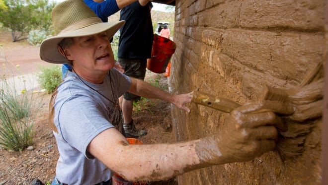 Former Tempe Mayor Hugh Hallman helps refresh the O'Connor House on April 28, 2017.  The O'Connor House is the former residence of Sandra Day O'Connor and her husband. The adobe home was moved from the couple's Paradise Valley lot to the Tempe portion of Papago Park.