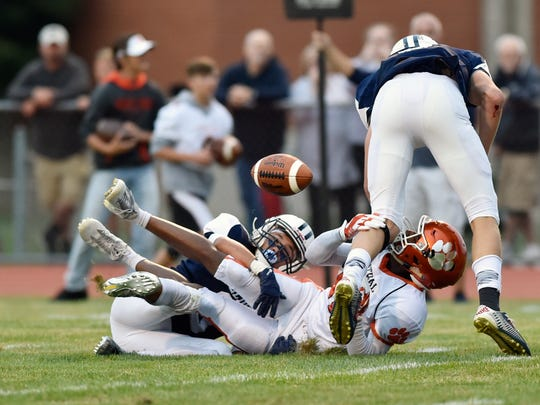 Central York's Tim Sturgis fumbles a reception in the