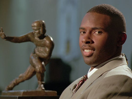 Florida State University quarterback Charlie Ward manages a smile while waiting to do a television interview at the Downtown Athletic Club in New York Saturday, December 11, 1993.  Earlier, Ward was named the 1993 Heisman Trophy winner.  (AP Photo/Bebeto Matthews)