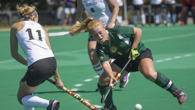 University of Vermont's Ashley McDonald, right, takes the ball from Providence's Emily Humiston, left, during the second half of play at UVM's Virtue Field, Friday, August 29, 2014.