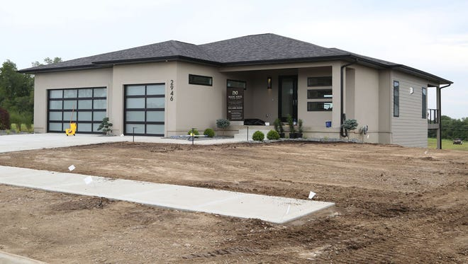 New home construction is on the rise in Norwalk, which offers a close commute and views of the Des Moines metro.Monday, July 7, 2014. House 6 on the Home Show Expo at The Ridge at Echo Valley in Norwalk is built by Marc Kris Modern Homes.
