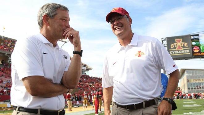 Kirk Ferentz, left, and Paul Rhoads