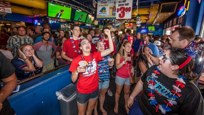 Fans gather at Grotto Pizza in Newark to watch the U.S. take on Germany in World Cup play Thursday afternoon.