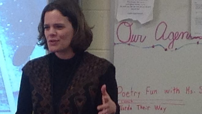 University of Wisconsin Marathon County Assistant Professor of English Jill Stukenberg gives a lesson on poetry to third graders at Mosinee Elementary School in February 2016.