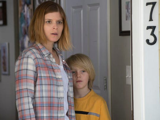 This image released by Lionsgate shows Kate Mara, left,