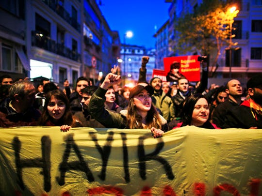 Supporters of the 'no' vote, (Hayir in Turkish) chant slogans during a protest against the referendum outcome, in Istanbul, Tuesday, April 18, 2017.  Hundreds of people are queuing in front of Turkey's election board in capital Ankara to submit petitions requesting that the electoral authority reverse a controversial decision during Sunday's referendum to accept ballots without official stamps, as required by Turkish law.