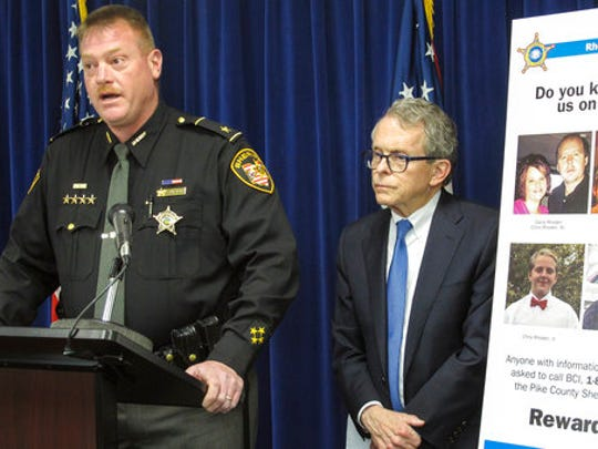 Pike County Sheriff Charles Reader, left, discusses the ongoing investigation into the unsolved killings of eight family members in southern Ohio on April 22, 2016, at a news conference attended by Attorney General Mike DeWine, whose office is leading the investigation, on Thursday, April 13, 2017, in Columbus, Ohio. Reader and DeWine both said they believe individuals may be holding back information out of fear of self-incrimination over their own, unrelated drug crimes.