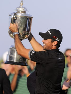 Jason Day celebrates with the Wanamaker Trophy on Sunday after winning the 2015 PGA Championship golf tournament at Whistling Straits.