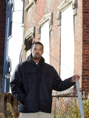 Dominic Duren, re-entry coordinator for returning citizens at St. Vincent de Paul, stands in the West End neighborhood where his office is located.