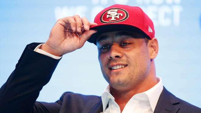 Jarryd Hayne speaks during a press conference in Sydney, Australia to announce that he has signed a NFL futures contract with the San Francisco 49ers.