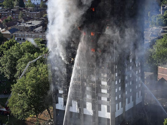 Firefighters tackle a huge fire that engulfed the 24-story Grenfell Tower in Latimer Road, West London in the early hours of this morning on June 14, 2017, in London, England.