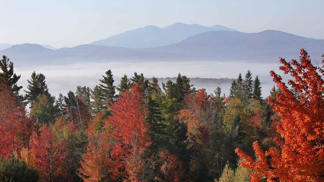 Fog and fall colors create an alluring scene in Milan, N.H., in 2014.