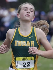 Marissa Ellenbecker won the Division 3 girls race during the WIAA state cross-country meet. She became only the second runner in the Edgar girls program history to win an individual title.
